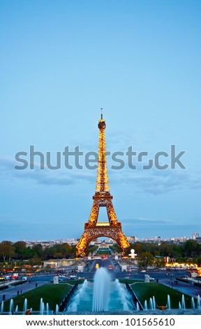 PARIS - APRIL 15 : Light Performance Show of Eiffel tower with twilight sky on April 15, 2012 in Paris. The tower is the most visited monument of Paris and France. - stock photo