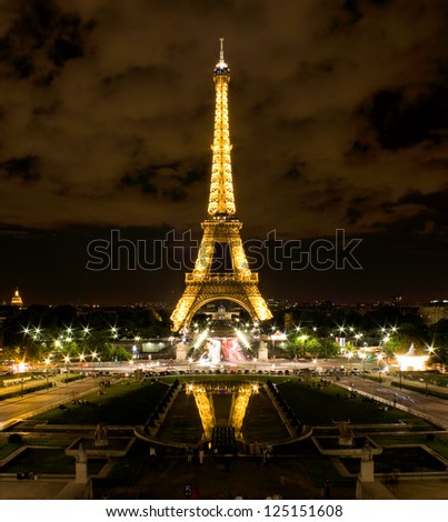 PARIS - APRIL 21: Light Performance Show on April 21, 2012 in Paris. The Eiffel tower stands 324 metres (1,063 ft) tall. Monument was built in 1889, attendance is over 7 millions people. - stock photo