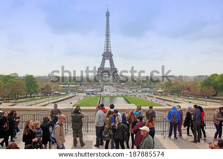 PARIS - APRIL 27:Locals and tourists at Eiffel tower, stands 324 metres (1,063 ft) tall. Monument was built in 1889, attendance is over 7 millions people in year. View on April 27, 2013 in Paris - stock photo