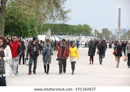 PARIS - APRIL 24 2013:People in the famous Tuileries garden in Paris. Tuileries Garden is a public garden located between the Louvre Museum and the Place de la Concorde and very popular sitte