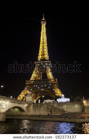 PARIS - APRIL 30: The Eiffel Tower at night on April 30, 2011 in Paris. The Eiffel tower is the most visited monument of France with about 6 million visitors every year.