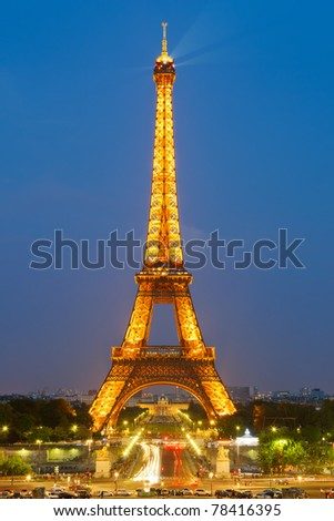 PARIS - APRIL 24: The Eiffel Tower is brightly illuminated at dusk on April 24, 2011 in Paris. Eiffel tower is the most visited payed monument in the world having over 6 million visitors annually. - stock photo