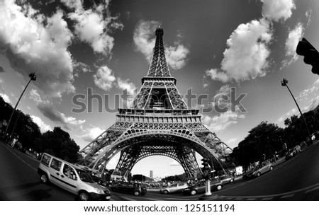 PARIS - APRIL 21: The Eiffel tower stands 324 metres (1,063 ft) tall. Monument was built in 1889, attendance is over 7 millions people. View on April 21, 2012 in Paris. - stock photo