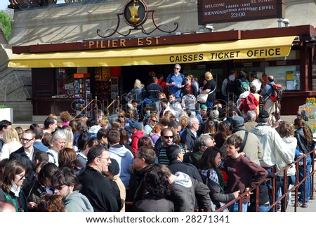 PARIS- APRIL 10: Thousands queue for Eiffel Tower after 1,5 day strike, where personnel demanded better work conditions, April 10, 2009 in Paris, France. 500 workers daily service ca 18,000 tourists.