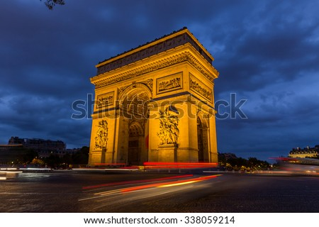 Paris Arc de Triomphe at night, France - stock photo