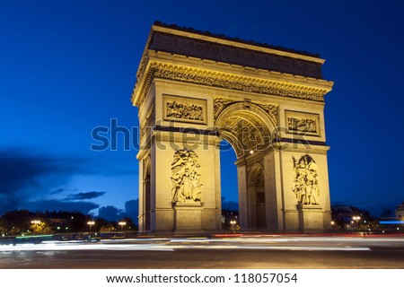 Paris, Arc de Triomphe by night with strips of vehicles - stock photo