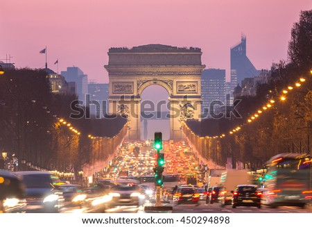 Paris Arc of Triomphe along Champs-Elysees France sunset