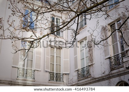 Paris architecture, streets and parks in springtime, sakura blossom in the city