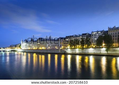 Paris at blue hour. Seine River in the Evening, Paris, France - stock photo
