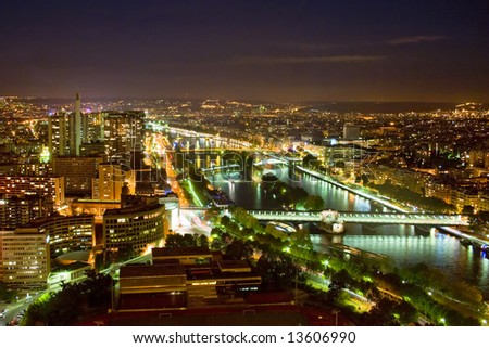 "Paris at night - view at the ""Bir Hakeim"" bridge on Sieine River with ""Île des Cygnes"" visible in the center - stock photo"