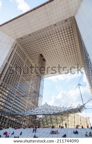 PARIS - AUGUST 05: Grande Arche in La Defense with unidentified people on August 05, 2014 in Paris. Its Europes largest business district with 560 ha area, 72 glass and steel buildings and skyscrapers - stock photo