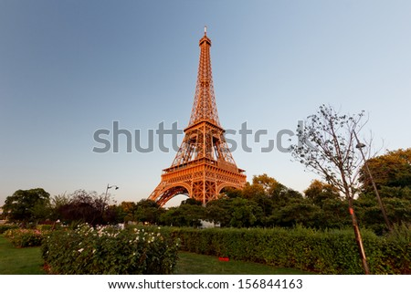 PARIS -  6  AUGUST  13: Illuminated Eiffel Tower at night and people on the Champs de Mars. The popular place for people for romantic evenings