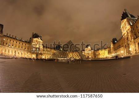 PARIS - AUGUST 24: Illuminated Louvre Museum marks 22nd Anniversary of I.M. Pei's glass pyramid on August 24, 2011 in Paris, France.