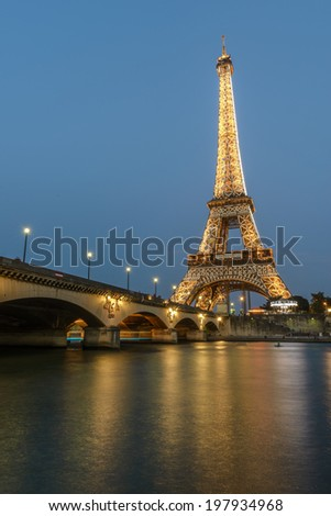 Paris - August 28: Long night Exposure of Eiffel Tower and Seine River at dusk from Port Debilly in Trocadero on August 28, 2013 in Paris, France - stock photo