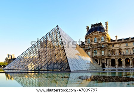 PARIS - AUGUST 24: Louvre Museum marks 20th Anniversary  of I.M. Pei's glass pyramid on August 24, 2009 in Paris, France - stock photo