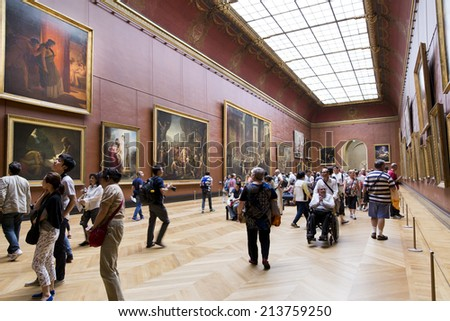 PARIS, August 6, 2014: People inside the Louvre Museum (Musee du Louvre) on August 6, 2014 in Paris, France. - stock photo