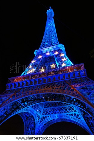 PARIS - AUGUST 1: The Eiffel Tower is shown in blue illumination in celebration of France's rotating six month presidency of the European Union (EU) August 1, 2008 in Paris, France. - stock photo