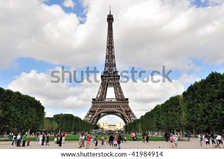 PARIS - AUGUST 21: The majestic Eiffel Tower is celebrating its 120th Anniversary as the world's most visited paid monument on August 21, 2009 in Paris, France. - stock photo
