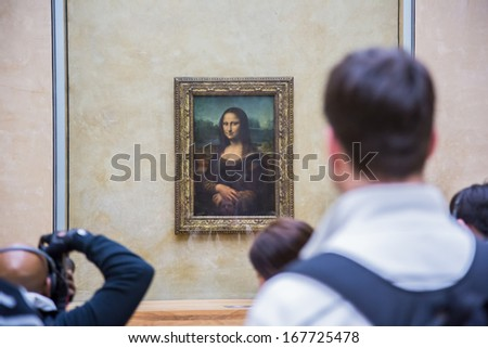 """PARIS - AUGUST 4: Visitors take photo of Leonardo DaVinci's """"Mona Lisa"""" at the Louvre Museum, August 4, 2012 in Paris, France. The painting is one of the world's most famous. - stock photo"""