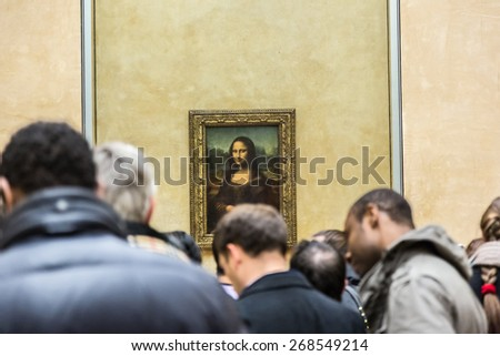 """PARIS - AUGUST 4: Visitors take photo of Leonardo DaVinci's """"Mona Lisa"""" at the Louvre Museum, August 4, 2013 in Paris, France. The painting is one of the world's most famous. - stock photo"""