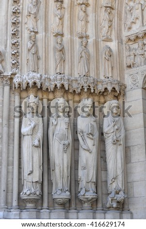 paris cathedral notre dame facade statue close up - stock photo