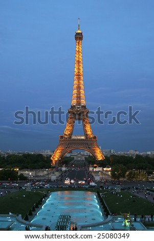 PARIS - CIRCA JULY 2007: The Eiffel Tower is shown illuminated at twilight circa July 2007 in Paris. The tower was completed and open to the public in 1889.