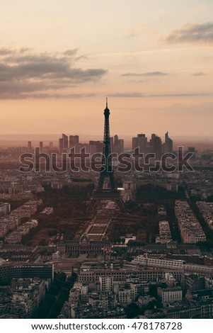 Paris city rooftop view with Eiffel Tower at sunset.