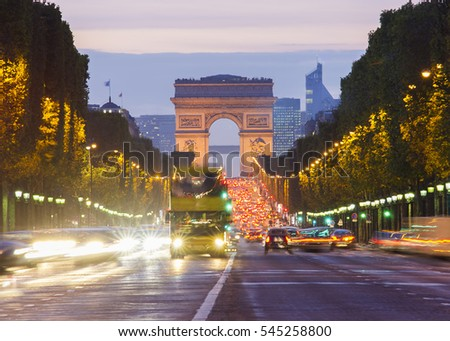 Paris city traffic on Champs Elysees boulevard