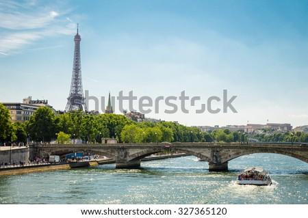 Paris cityscape - Eiffel Tower, bridge and Seine river - stock photo