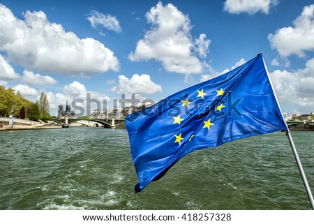 paris cityscape old houses landscape huge panorama view from seine river boat with european community waving flag - stock photo
