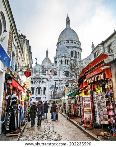 PARIS - DEC 26, 2008: Basilica of Sacre Coeur. In the center it is located the Bibliotheque publique d'information, and Musee National d'Art Moderne. - stock photo