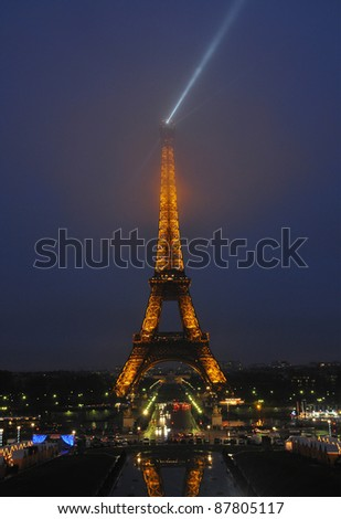 PARIS - DEC 29: Eiffel Tower light show at dusk, closeup on December 29, 2010 in Paris, France. Eiffel Tower is the highest monument in France use 20,000 light bulbs in the show.