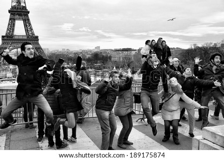 PARIS-DEC 31, 2013:Every day crowds of tourists descend on the Esplanade du Trocadero to pose for pictures with the Eiffel Tower in the background.The spot has  the best view of the iconic structure. - stock photo