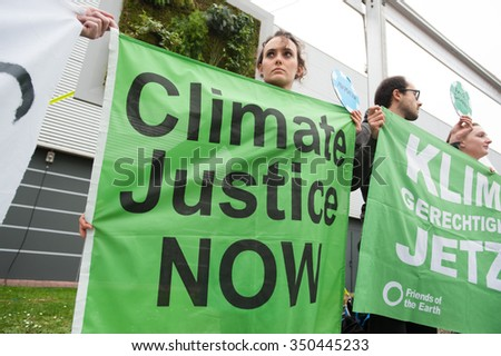 "PARIS - DECEMBER 1: Climate activists at the COP21 UN climate summit in Paris, France, stage a protest calling for ""climate justice now"", December 1, 2015."