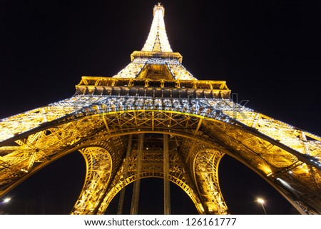 PARIS - DECEMBER 2 : Eiffel tower at night, December 2, 2012 in Paris. The tower is the tallest structure in Paris and the most-visited paid monument in the world.