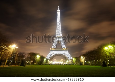 PARIS - DECEMBER 29: Eiffel Tower illuminated at night, view from the Champs de Mars, December 29, 2009, Paris, France. It was named after its creator - Gustave Eiffel. - stock photo