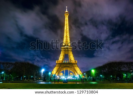 PARIS - DECEMBER 05: Lighting the Eiffel Tower on December 05, 2012 in Paris. The Eiffel tower is the most visited monument of France with about 6 million visitors every year. - stock photo