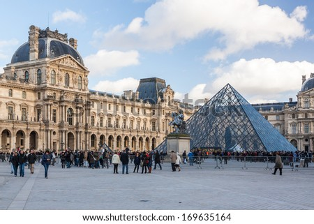 PARIS - DECEMBER 26, 2013: Louvre Museum on December 26, 2013 in Paris. The Louvre Museum is the most famous and most visited museum of the world with about 8 million visitors every year. - stock photo