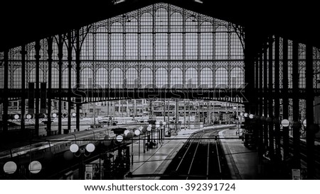 PARIS - December 6: passengers arrive and depart at Gare du Nord station on December 5, 2014 in Paris, France. With 190 million travelers a year this station is the busiest railway station in Europe. - stock photo