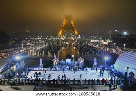 PARIS - DECEMBER 27: People ice skating at night in front of Eiffel Tower on December 27, 2012 in Paris, France. Eiffel Tower is the highest iconic monument in France. - stock photo