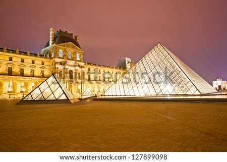 PARIS-DECEMBER 06: The Louvre Museum on December 06, 2012 in Paris, France. A central landmark of Paris, over 35000 objects from prehistory to the 19th century are exhibited over area of 60600 sq m. - stock photo