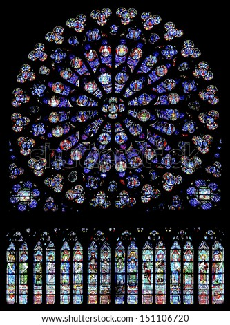 PARIS - DECEMBER 18: The North Rose window at Notre Dame cathedral dates from 1250 and is also 12.9 meters in diameter. Its main theme is the  Old Testament. Shot in Paris, December 18, 2012 - stock photo