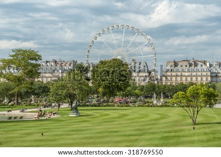Paris during the summer with a funfair by the Louvre - stock photo