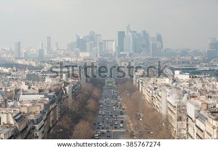 PARIS - FEB 3: air pollution and traffic jam at Champs-Elysees Avenue on 3 February, 2014 in Paris, France. Paris has the worst traffic jams in Europe, especially during the rush hours. - stock photo
