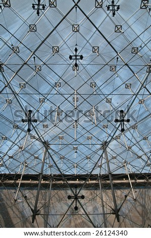PARIS - FEBRUARY 28: the glass panels of the pyramid in the louvre in Paris on February 28, 2009 in Paris. - stock photo