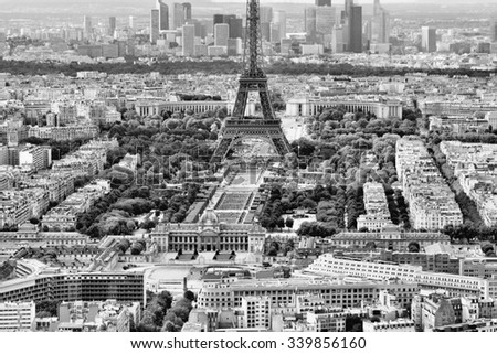 Paris, France - aerial city view Eiffel Tower and La Defense district. UNESCO World Heritage Site. Black and white retro style. - stock photo