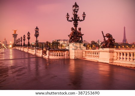 Paris, France: Alexandre III Bridge at sunrise with Eiffel Tower (on right) and Hôtel des Invalides (on left).
