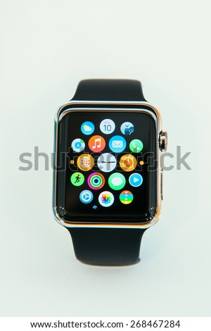 PARIS, FRANCE -?? APR 10, 2014: New wearable computer Apple Watch smartwatch displaying the interface home screen. Apple Watch has fitness tracking and health-oriented capabilities with iOS products - stock photo