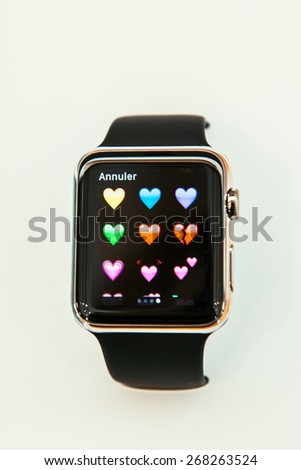 PARIS, FRANCE - APR 10, 2015: New wearable computer Apple Watch smartwatch displaying the Hearts Emoji. - stock photo