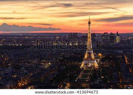PARIS, FRANCE- APRIL 14, 2016: Aerial view of Eiffel Tower with light performance show. Eiffel Tower is the famous landmark of Paris.